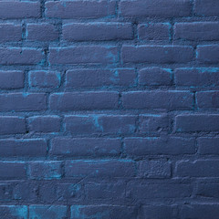 dark blue painted part of brick wall
