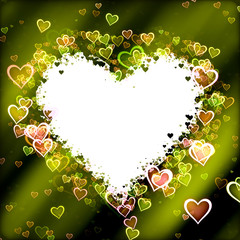 Frame heart-shaped and green background