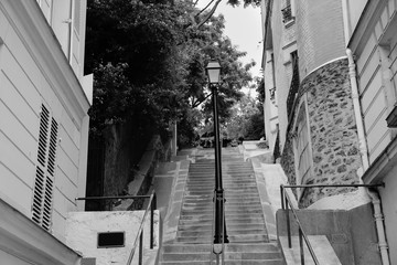 Montmartre stone stairs path in Paris, black and white
