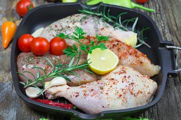 Raw chicken drumstick in pan - chicken raw meat