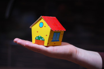 model of house in hand