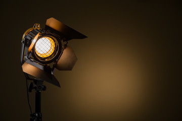 Aluminium Prints Light, shadow Halogen spotlight with a Fresnel lens. Spot light on the wall. TV, video, photo, shooting