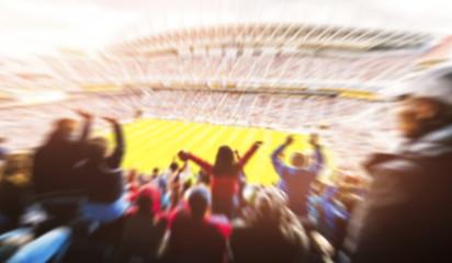 Football- Soccer,a lot of fans  in full stadium celebrate goal. -blurred