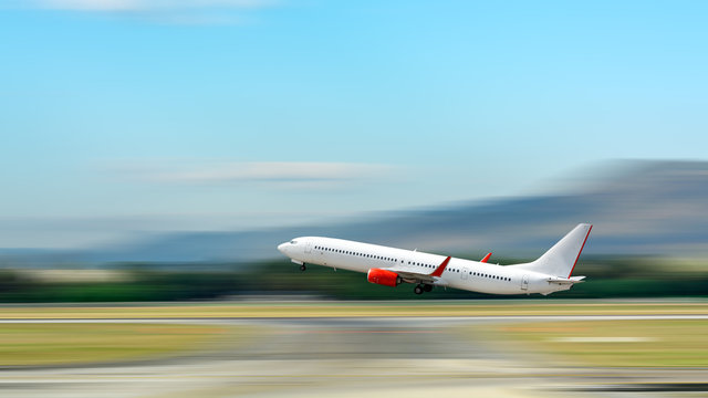 Airplane take off. Motion blur effect.