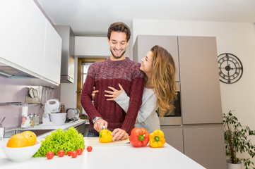 Loving couple coocking vegetables at the kitchen.