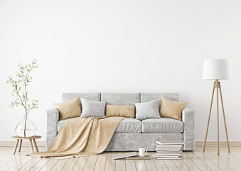 Empty white wall mockup with sofa, pillows, plaid and lamp on the floor. 3D rendering.