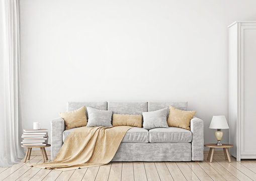 Livingroom Interior with sofa, pillows and plaid  on empty white wall background. 3D rendering.