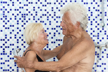 senior couple happy to take a shpwer after swimming