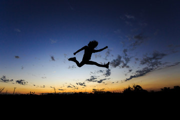 Man jumping at sunset. Freedom, risk, challenge, success.