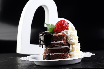 Chocolate yule log christmas cake. Valentine day cake with straw