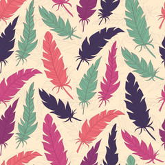 Seamless background vintage colored feathers. Pattern.