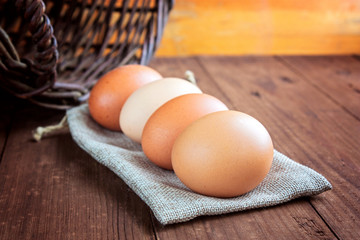 eggs and basket on a wooden background