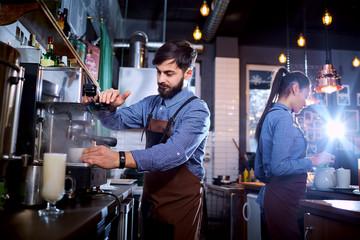Fototapeta Barman barista uniform making coffee tea cocktails in the bar, restaurant, shop. obraz