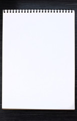 Blank open notepad for  sketching  on wooden table