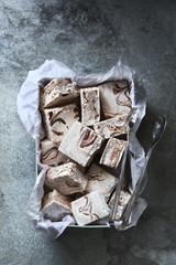 Homemade chocolate swirl marshmallows on a metal box.Top view