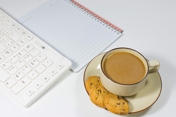 Office table with keyboard note pencil and coffee on white background