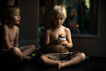 Two boys with one cupcake