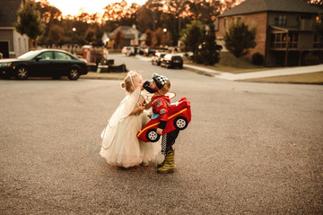 Young boy and girl wearing fancy dress costume, kissing