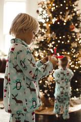 Young boys decorating christmas tree
