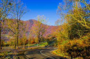 autumn landscape, the road leading into the mountains, blue moun