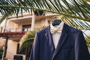 wedding suit hanging outside