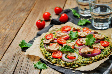 Kale oats pizza crust with tomato, red onion and mushrooms