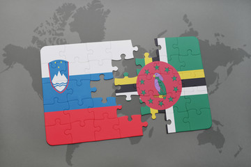 puzzle with the national flag of slovenia and dominica on a world map