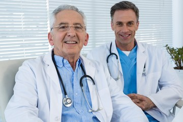 Portrait of smiling doctors sitting at table