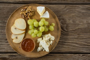 Cheese with grapes, apple slices, walnuts