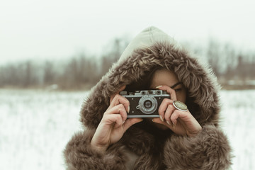 Woman taking a photo in nature on a winter day