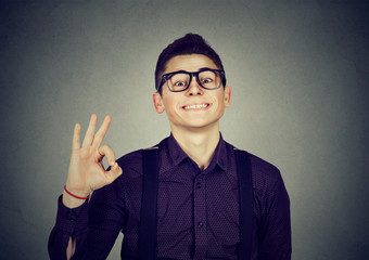 Successful teenager with ok sign