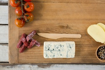Roquefort cheese, wooden knife, cherry tomatoes