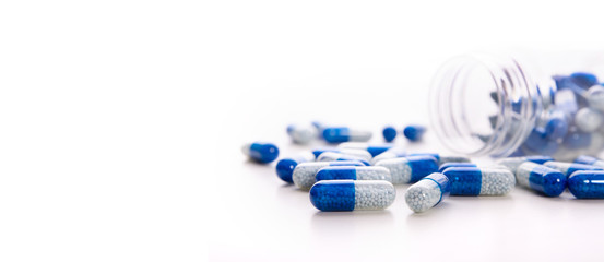Pile of scattered capsules on a white background