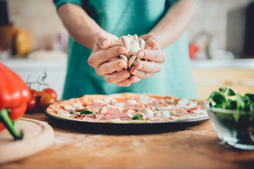 Woman preparing pizza