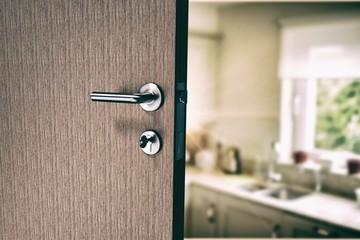 Composite image of closeup of door with doorknob and key