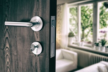 Composite image of brown door with metal doorknob and lock