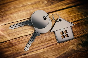 Composite image of metallic key with home ring