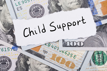 Child Support Note Placed On Top Of Dollar