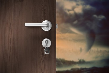 Composite image of brown door with house key