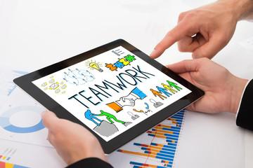 Businesspeople Discussing Teamwork On Digital Tablet