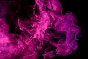 Abstract smoke Weipa. Personal vaporizers fragrant steam. The concept of alternative non-nicotine smoking. Magenta smoke on a black background. E-cigarette. Evaporator. Taking Close-up. Vaping.