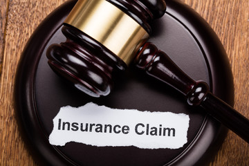 Insurance Claim Concept On Wooden Gavel