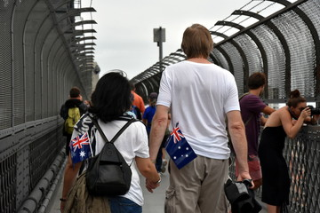 A couple celebrating Australia Day in Sydney. Australia flags in the bag.