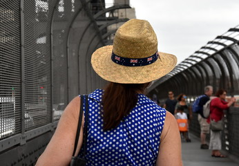 A lady celebrating Australia Day in Sydney. Australia flag decorates the hat.