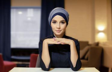 portrait of a beautiful girl eastern appearance in the Muslim headdress
