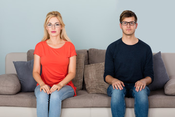 Man And Woman Wearing Eyeglasses On Couch