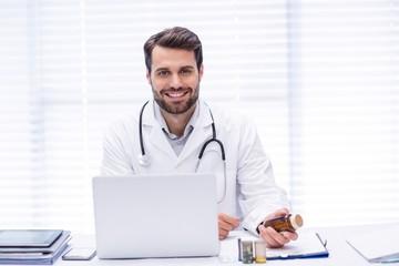 Portrait of male doctor checking medicine