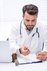 Male doctor checking medicine