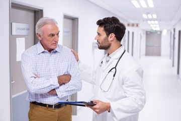 Doctor interacting with patient in corridor