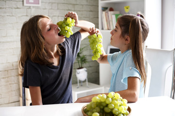 Teenagers eating grapes